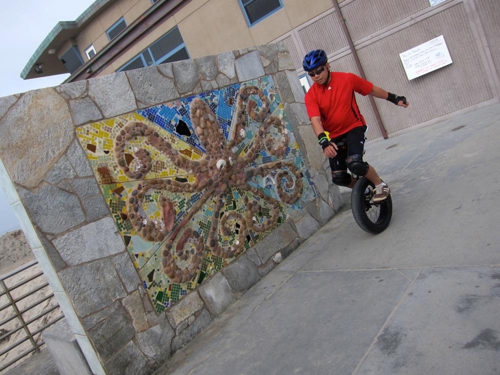 Unicycle Mission Beach boardwalk